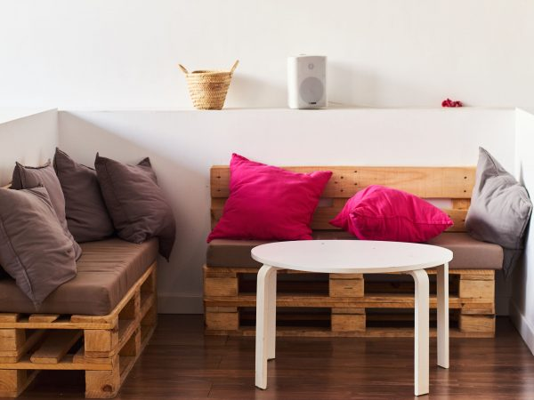 Wooden pallet sofas with colorful pillows.